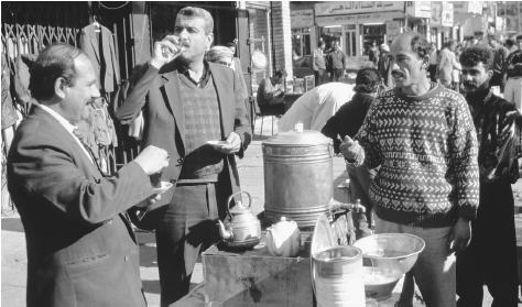 Iraqi men socialize at a tea stall in Baghdad.