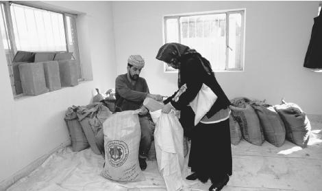 An Iraqi woman collects her monthly food rations from the Red Cross in Baghdad.