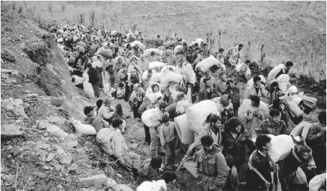 In March 1991, two million Kurds fled Iraq, settling at camps on the border to wait for humanitarian aid.