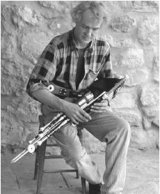 Eugene Lamb, an uillean pipe maker in Kinvara, County Galway, holds one of his wares.
