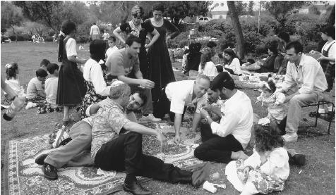 A Sephardic family celebrates the Jewish festival of Passover by sharing a picnic in West Jerusalem.