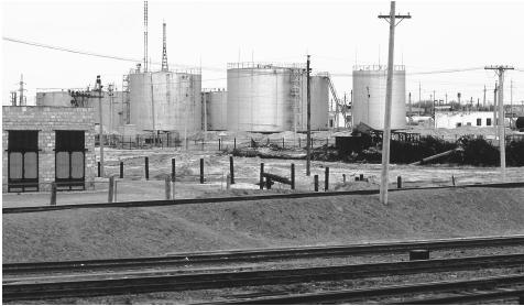 Oil refineries next to train tracks near Kul'Sary, Kazakhstan. Oil is one of the major industries in Kazakhstan.