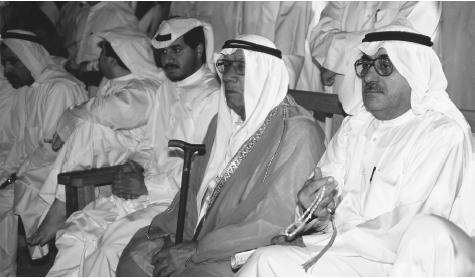 Kuwaiti men in traditional robes attend a meeting in Kuwait.