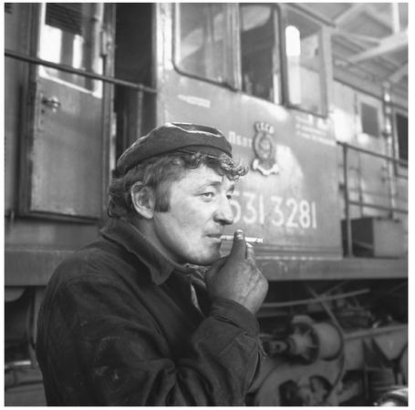 A Lithuanian railroad worker takes a break. Commercial activity in Lithuania is largely determined by geographical region.