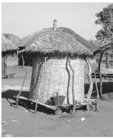 A thatched grain store in a Malawian village. Because Malawi produces no manufactured goods for export, it has an agricultural economy.
