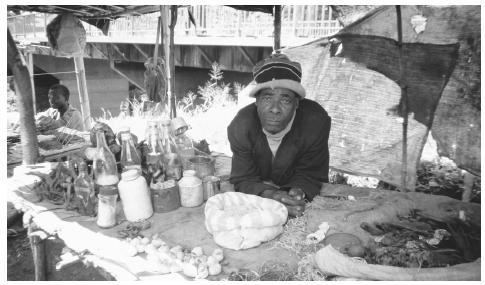 A medicine man selling herbs at a market in Blantyre. Medicine men are sought out to cure illness and to aid in such tasks as finding a wife.