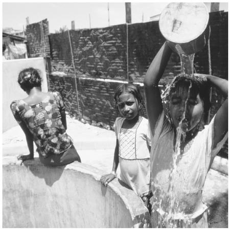 Young girls gather at a well. Almost half of the country's population is under fifteen years of age.