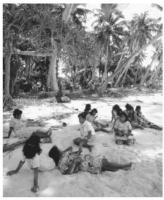 People relaxing on a beach in Majuro, Ratak. The average temperature on the Marshall Islands is 81 degrees.