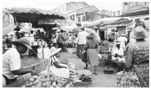 Produce and goods for sale at an open-air market in Saint-Pierre. Traditional meals are a combination of French and Creole cuisines.