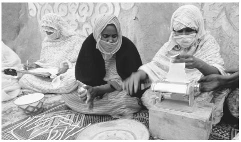 Women making pasta at a women's cooperative in Walata. Most Mauritanians work as farmers, cattle herders, or traders.