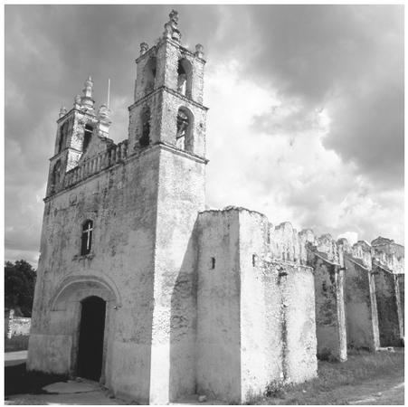 This colonial church with two bell towers was built with ancient Maya stones. Spanish and French architectural traditions influenced Mexican buildings.