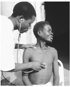 A doctor examining a TB patient in Morrumbala Hospital. The civil war took a heavy toll on medical care throughout the country.