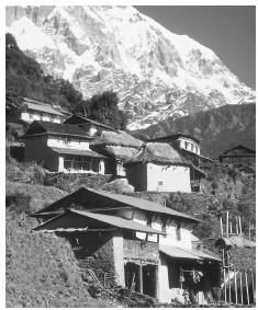 The village of Siklis, in the Himalayas. Village houses are usually clustered in river valleys or along ridge tops.