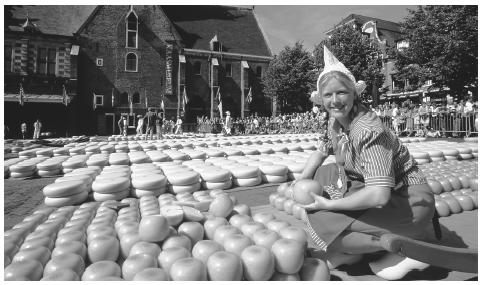 A woman selling cheese at the market in Alkmaar. The Netherlands has an advanced free market economy.