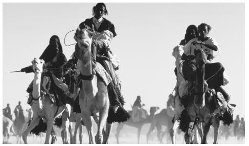 Tuareg camel-riders, Tamazlak. The Tuareg form 10 percent of the population.