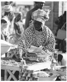 A woman buying peppers at the market in Naimey; there are permanent markets in major towns and market days in rural communities.