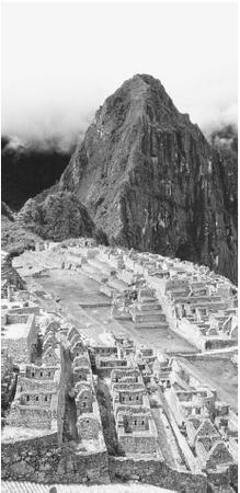 Remaining structures of the ruined city of Machu Picchu, built by the Incas in the Andes.