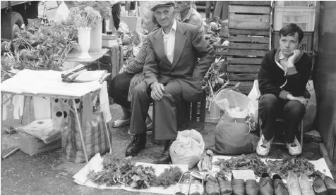 Produce and shoe merchants at a market in Plock.