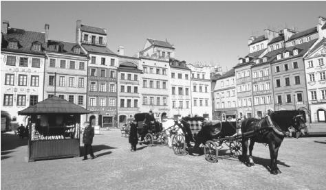 Horse-drawn carriages await passengers in a square in Old Town Warsaw. Warsaw has been Poland's capital since 1611, when it succeeded Cracow.