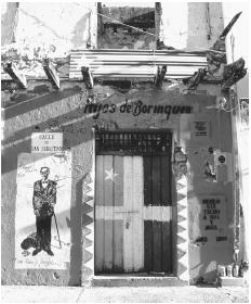 A doorway painted to represent the flag used in the 1868 Lares Insurrection.