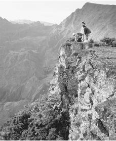Hikers gaze on the beauty of Cirque de Malfate from the peak of Piton Meido on Reunion Island.