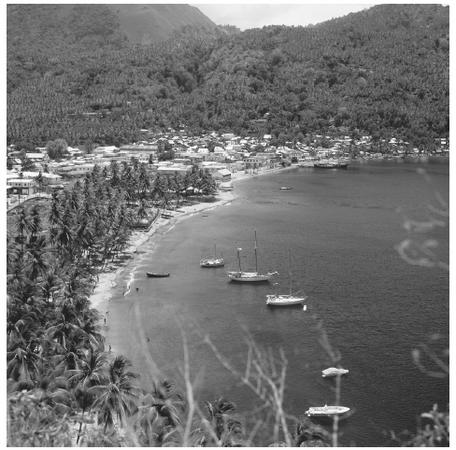 Boats in a cove in Sonfiere. Many original settlements began as fishing villages.