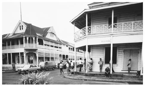 People under the portico of the immigration office as traffic passes by in Apia. Ethnic tensions are virtually non-existent in Samoa.
