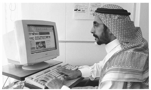 A Saudi man using the Internet in his office in Riyadh. There are substantial variations in the amount of income and accumulated wealth among Saudi Arabians.