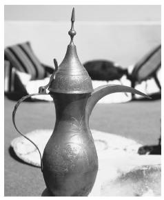 An Arabian coffee pot.