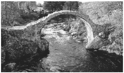 A stone footbridge in the highlands of Scotland. The highlands have rugged terrain that is difficult to cultivate.