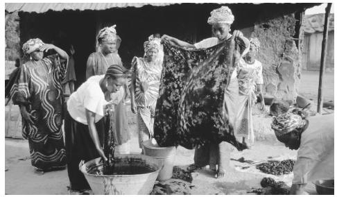 A group of women belonging to a cooperative make garas, a traditional tie-dyed cloth.