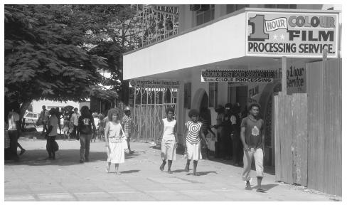 Residents of Honiara stroll on the street. As many as seventy distinct languages are spoken in the islands; one legacy of British colonizers is the use of English in formal places.
