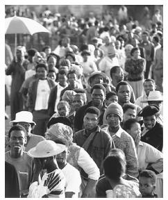 Voters wait in line in the first all-race elections, 1994. All South Africans have had the right to vote since this landmark year.