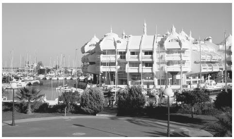 Apartments next to a marina in Malaga. Urban families often share bedrooms, and common rooms may be used for multiple purposes.