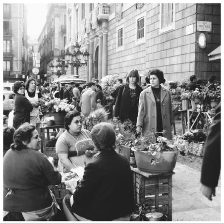 Several women in the flower section of the Rastro Market in Madrid. Spaniards have long accepted the independence of women.
