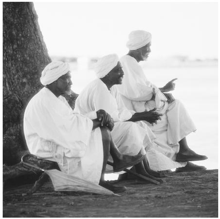 Three men sit by the river in the Ali-Abu region of Sudan. Seventy percent of Sudanese are Sunni Muslim.
