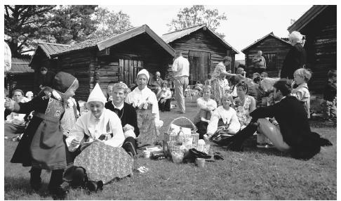 A mid-summer festival featuring traditional Swedish dress and activities.
