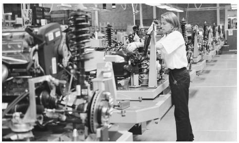 A worker assembles parts in an automobile plant in Göteborg. Automobile manufacturing is just one part of Sweden's highly diverse industrial base.