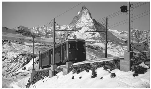 The Matterhorn towers beyond a railway as it ascends toward Gornergrat. Skiing and tourism are an important part of the Swiss economy.