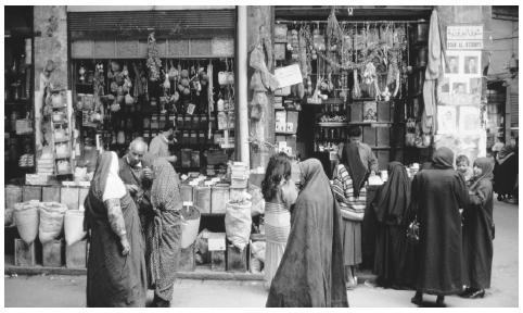 People walk around the bazaar in Damascus. The marketplace is the focal point of every Syrian city.