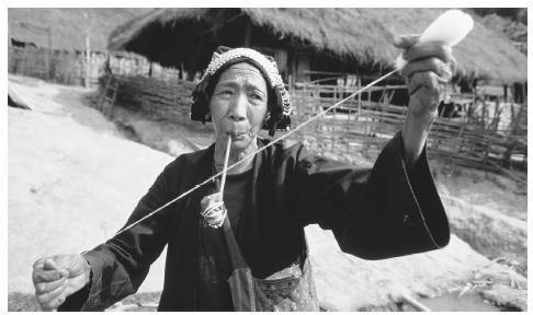 An Akha woman hand spinning wool. Though women have made many advancements in Thailand, they are concentrated in lower-paying jobs.