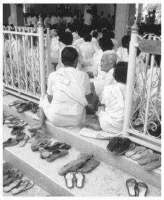 Footwear is removed when attending a ceremony near the Mae Nam Noi River, Thailand.