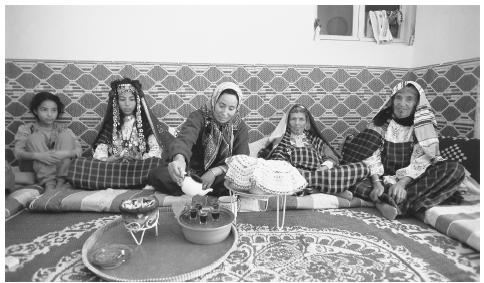 A bedouin family drink tea in Matmata. Tunisian families are patriarchal.