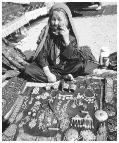 A woman sells jewelry at the Ashkhabad Sunday bazaar market. Silver jewelry is common.