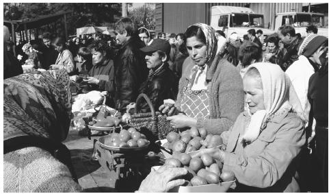 Traders sell food at a Sunday market in Kiev. A marketplace is the centerpiece of almost every town and village.