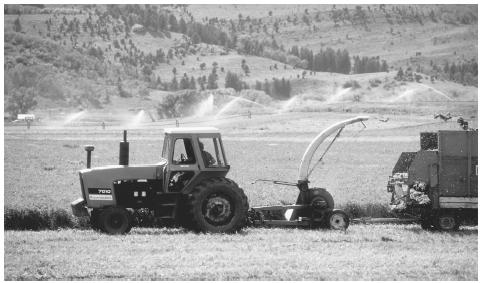 A tractor harvesting crops in the western United States. The U.S. is the world's leading food exporter.