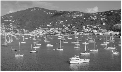 Boats in the Charlotte Amalie Harbor, Saint Thomas. Two million tourists visit the islands annually; two-thirds of them are cruiseship passengers.