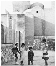 Children walking home after school. As children grow older, school discipline increases.