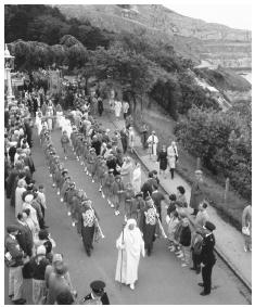 A procession heading to the National Eisteddfod Festival in Llandudno, Wales.
