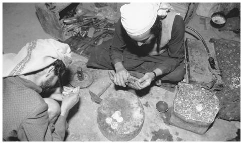 Two Jewish jewelers at work in north Sana'a. Goods produced by small vendors are an important part of market-based commercial activity.